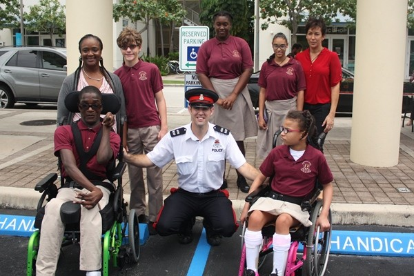 Seven Mile Beach Community Officer Spearheads Disabled Parking Sign Initiative at Camana Bay, 23 May