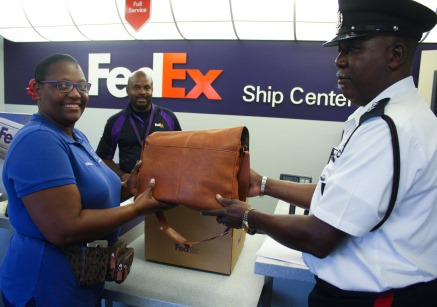 RCIPS and FedEx Assist Local Taxi Operator in Reuniting a Visitor with her Lost Handbag