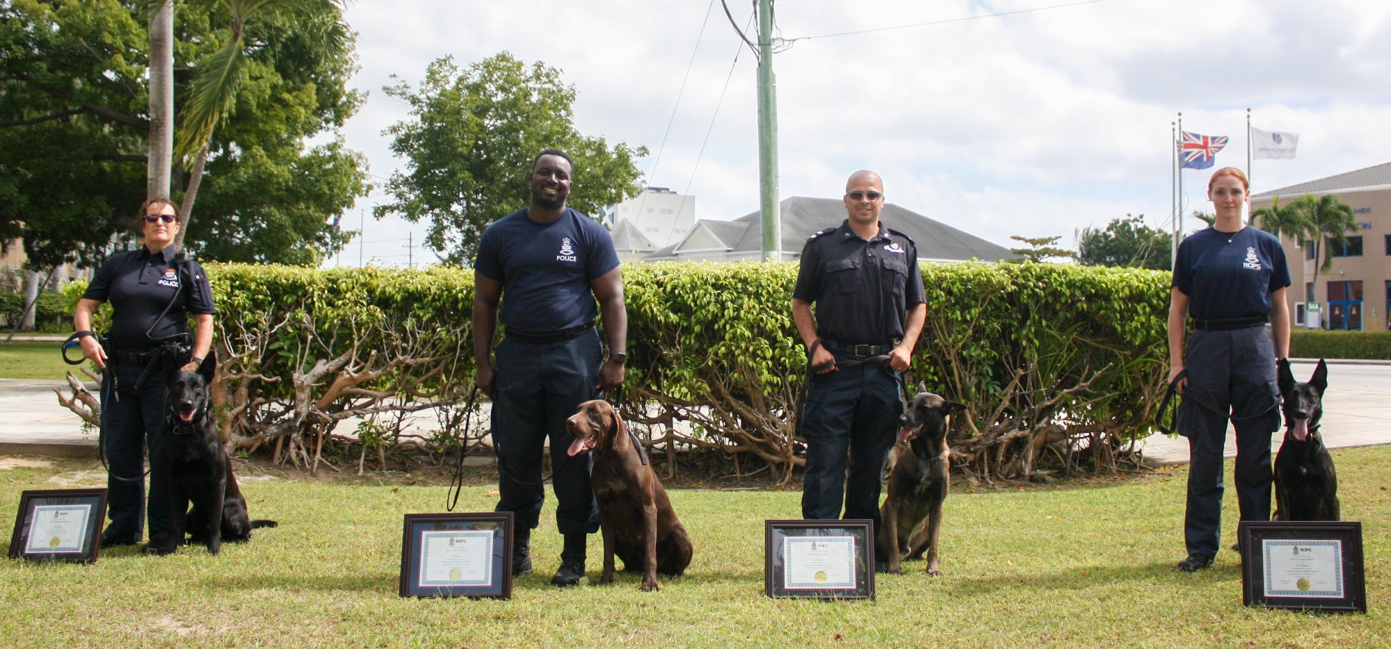 The K-9 officers pose with their dogs.