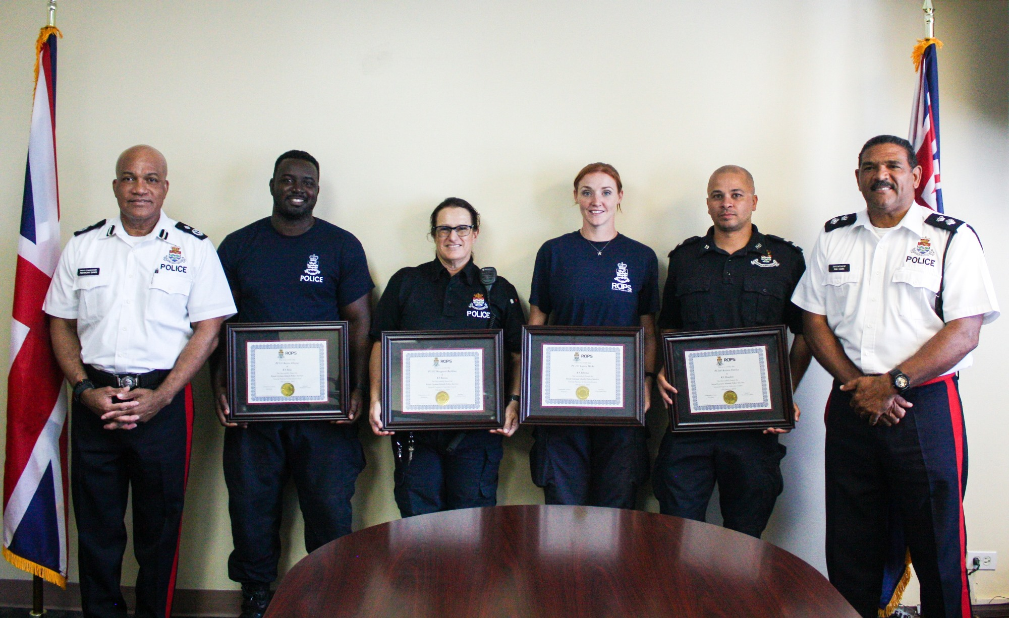 The K-9 officers are presented their certificates by Deputy Commissioner Ennis and A/Superintendent Brad Ebanks