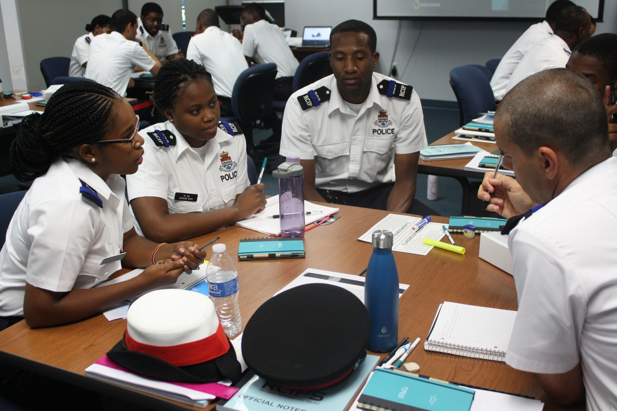 A group of recruits discuss an example case.