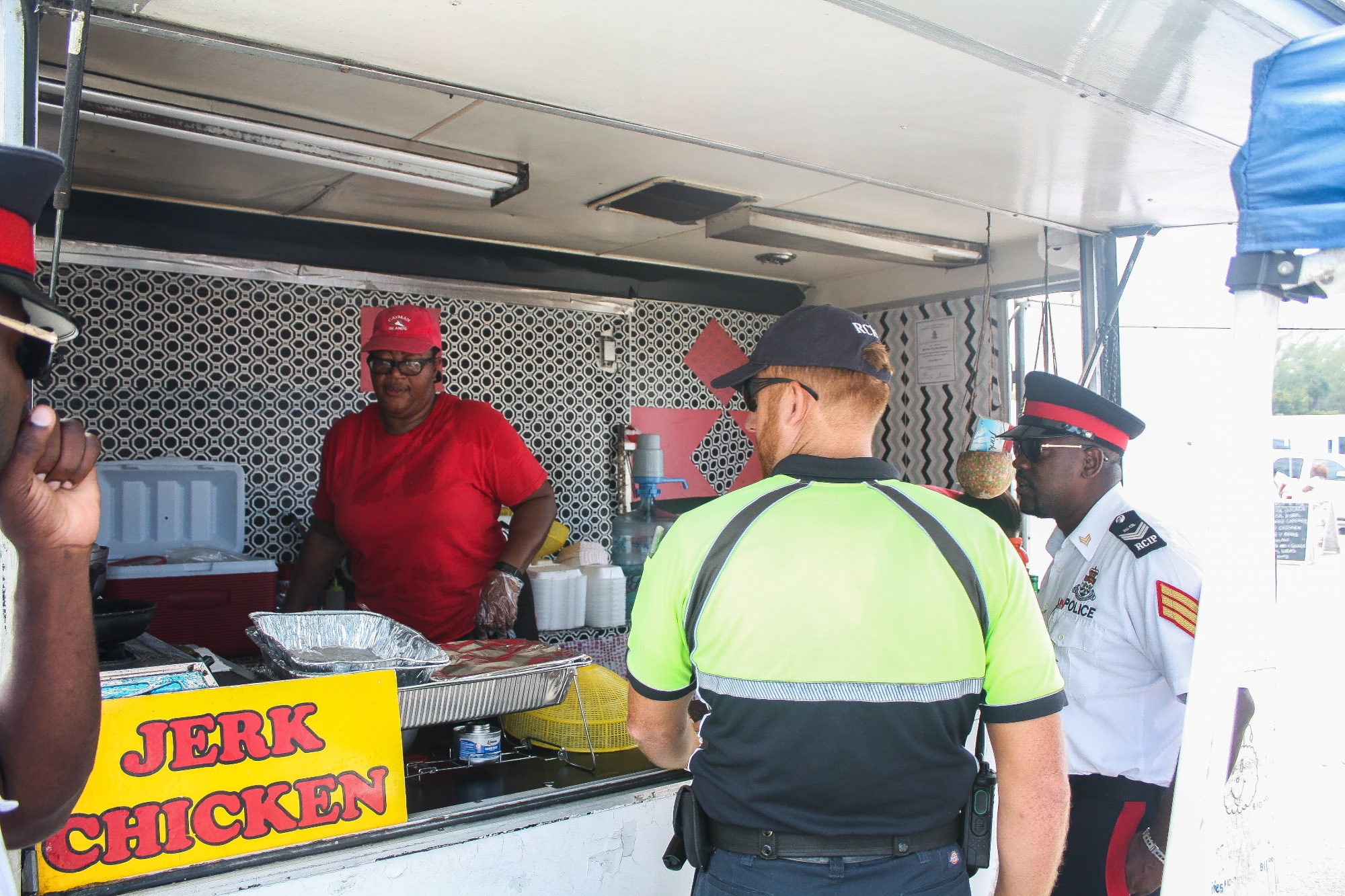 Officers speak to food vendors on the beach.