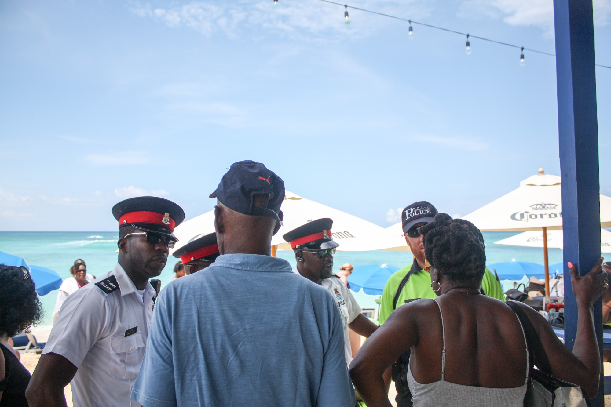 Officers interact with visitors on the beach.