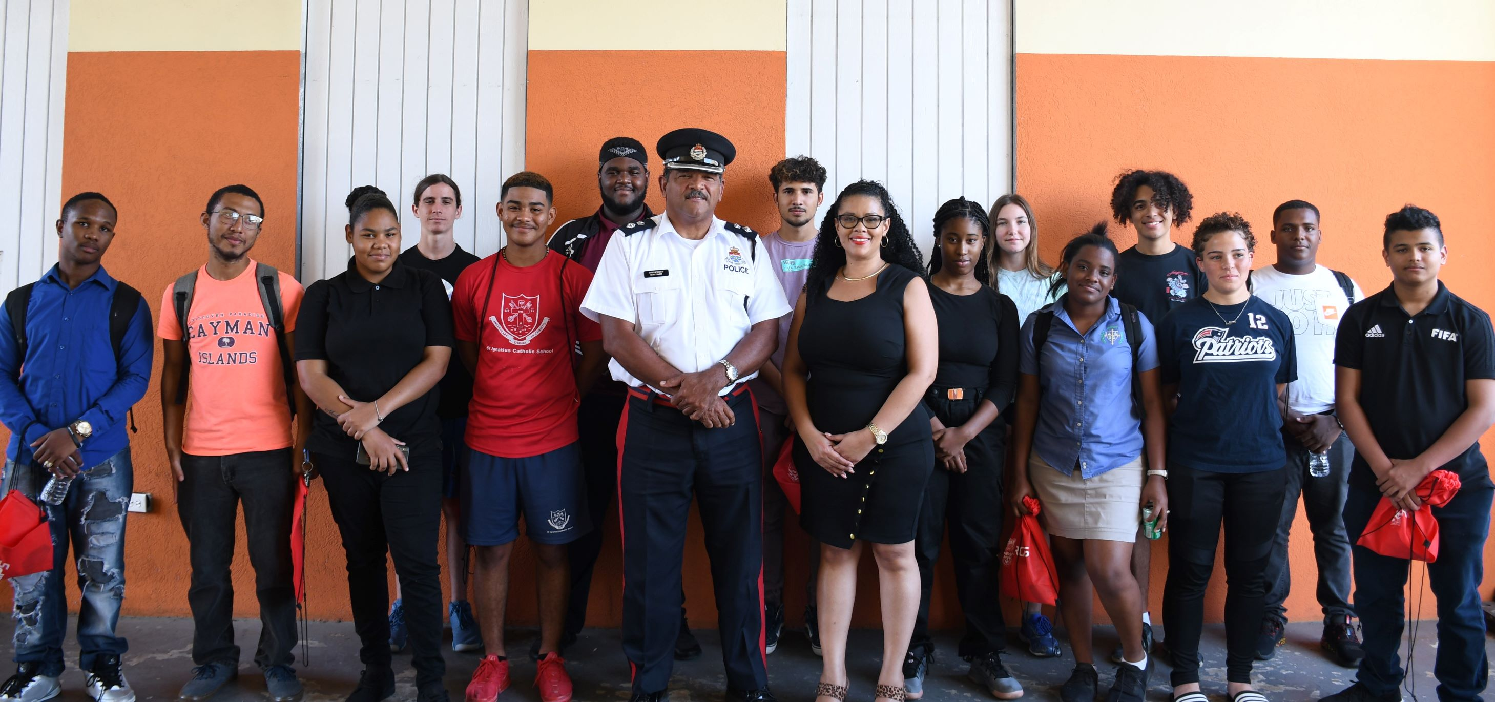 A/Supt. Brad Ebanks & HR Officer Samantha Bodden pose with the tour participants.