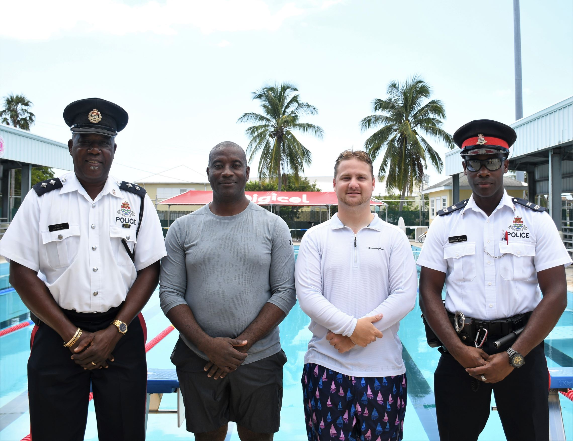 AC O'Connor and AC Dixon (middle left and right) worked with the children in the pool and were joined by Inspector Myles and PC Donaldson (far left and right) at the Lion's Aquatic Centre.