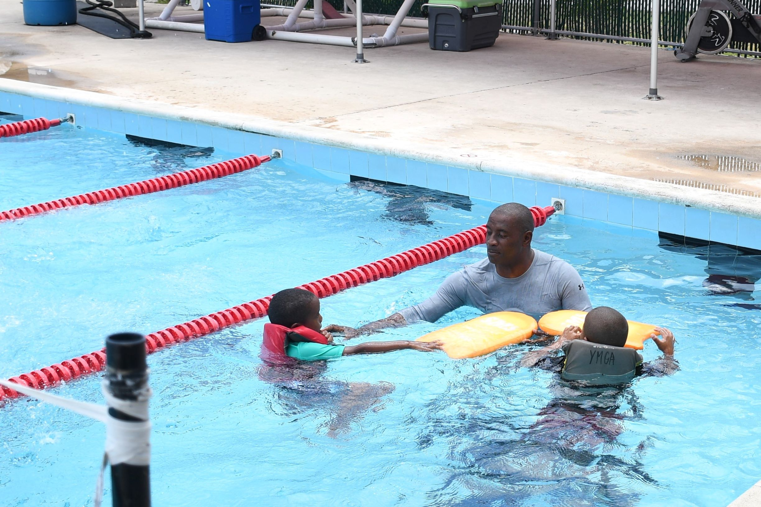 AC O'Connor gives swimming pointers to two of the students.