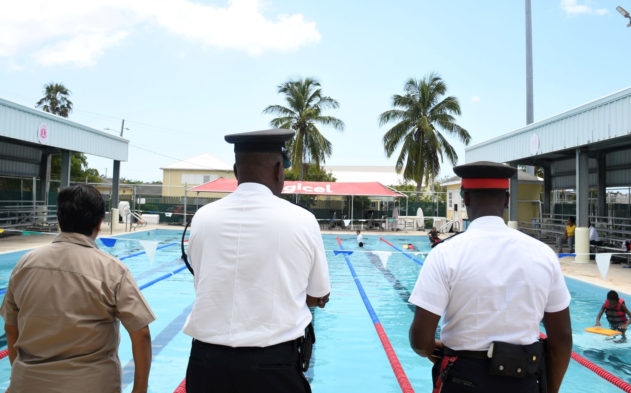 Susan Poy Fong-Ramkissoon of the Primary Inclusion Unit, observes the swimming session along with Inspector Myles and PC Donaldson.